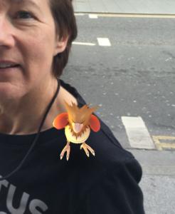 Pokemon monster on the Old Girl's shoulder