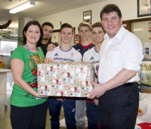 The gymnasts with MP Stephen Metcalfe, hospital staff and patients