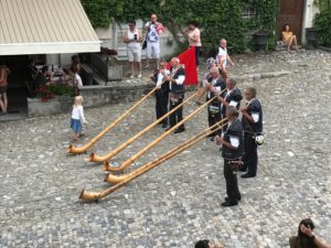 Men from Gruyere playing Alpenhorns