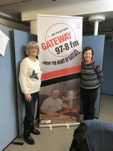 Jacqui and me by the Gateway 97.8 sign
